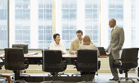 Four people sitting around a conference table