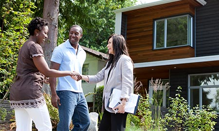Realtor congratulating a couple on their new home