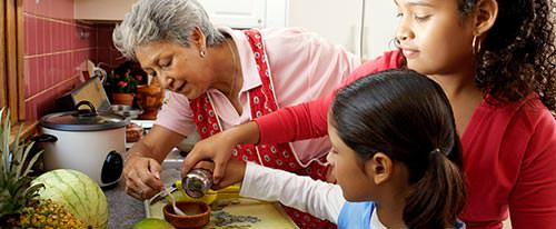 grandmother cooking with grandchildren