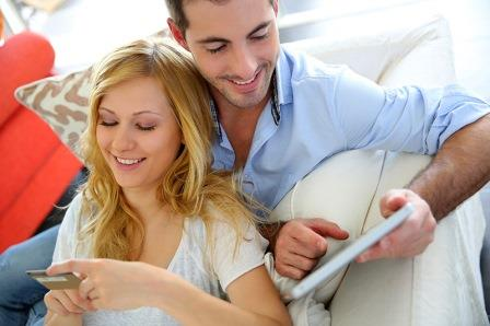 Young couple with a tablet and a credit card